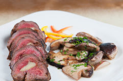 Sliced roast beef. Roast beef with mushrooms and sauce stock image