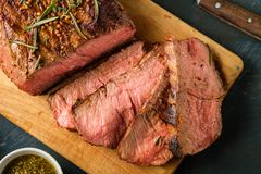 Sliced Roast beef on cutting board with grilled vegetables. Top Stock Images