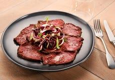 Sliced roast beef with radicchio salad Royalty Free Stock Images