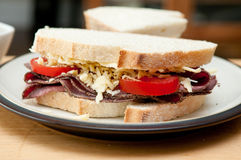 Sliced roast beef sandwich cheese and tomato and cole slaw. Sliced roast beef sandwich with cheese and tomato and cole slaw Stock Photography