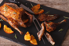 Sliced roast duck and closeup on a black slate board. Horizontal Stock Image