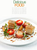 Sliced roast pork belly on a plate . Royalty Free Stock Image