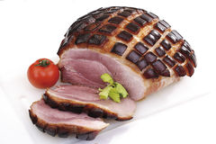 Sliced Roast Pork with Crackling, tomato and herb Stock Photos
