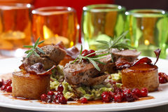Sliced roasted beef with potatoes and cranberries Royalty Free Stock Photography