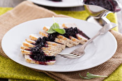 Sliced roasted pork served with berry sauce Royalty Free Stock Images