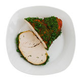 Sliced roasted turkey breast on plate. Isolated on white background royalty free stock images