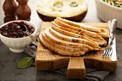 Sliced roasted turkey breast for Thanksgiving or Christmas. Dinner royalty free stock photos