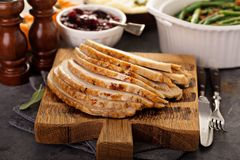 Sliced roasted turkey breast for Thanksgiving or Christmas. Dinner stock images