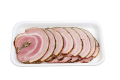 Sliced roll of a baked pork on plastic tray Royalty Free Stock Image