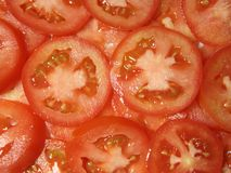 Sliced Roma tomatoes Stock Images