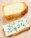 Sliced roquefort cheese Stock Photos