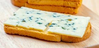 Sliced roquefort cheese Stock Photo