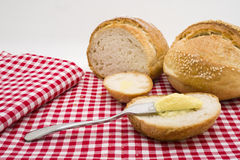 Sliced of round bread with butter Stock Image