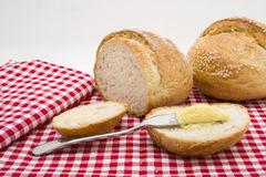 Sliced of round bread with butter Stock Photography