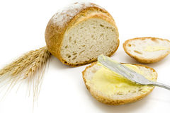 Sliced of round bread with butter Royalty Free Stock Photo