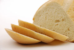 Sliced round sourdough bread with knife Royalty Free Stock Images