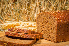 Sliced rye bread a background of hay Royalty Free Stock Photography