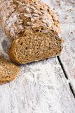 Bakery concept. Plenty of sliced rye bread background. Sliced rye bread, bakery background on rustic wood, closeup, copy space royalty free stock photography