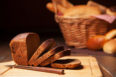 Sliced rye bread and basket Stock Image