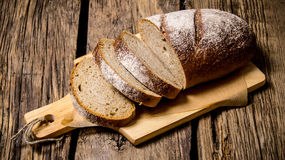 Sliced rye bread on a Board. On wooden table. Stock Images
