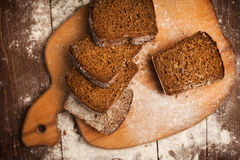 Sliced rye bread on cutting board closeup on table Stock Photo