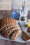 Sliced rye bread with a knife, walnuts, pear, pepper,verti. Cally Stock Photo