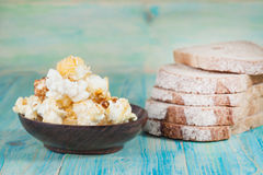 Sliced rye bread and pop corn Stock Image