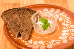 Sliced rye bread and salt shaker. Stock Image