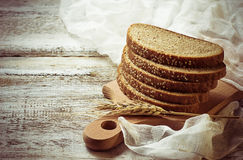 Sliced rye bread with sesame seeds Royalty Free Stock Images