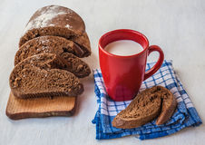 Sliced rye bread Tabatiere on a cutting board and  red cup with Stock Photos