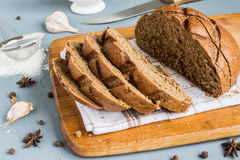 Sliced rye bread on towel on table with spices Royalty Free Stock Photo