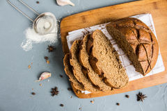 Sliced rye bread on towel on table with spices Stock Image
