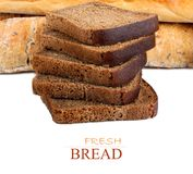 Sliced rye bread and two loaves of wheat flour Stock Images