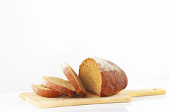 Sliced rye bread on a wooden cutting board. Closeup Royalty Free Stock Photography