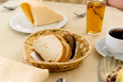 Sliced rye and wheat bread in wicker basket stock images