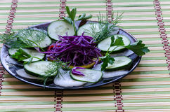 Sliced salad on a plate. Recent sliced salad on a black plate Stock Photos