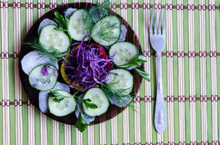 Sliced salad on a plate. Recent sliced salad on a black plate Royalty Free Stock Images