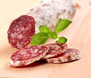 Sliced salami. Close-up shot stock images