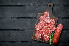 Sliced salami on the Board stock photo