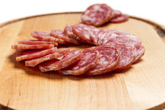 Sliced salami in circle shape Royalty Free Stock Images