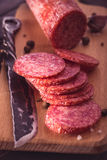 Sliced salami on cutting board closeup Royalty Free Stock Images