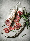 Sliced salami flavored with rosemary and spices. Royalty Free Stock Images