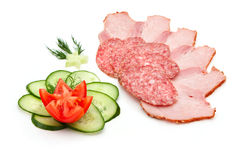 Sliced salami and ham. With cucumber and tomato  isolated on a white background Stock Photo