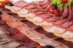 Sliced salami, parma, and ham Stock Photography