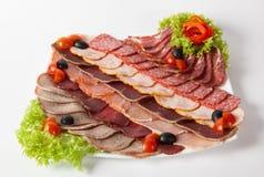 Sliced salami, parma, and ham Stock Photos