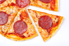Sliced salami pizza isolated Stock Images