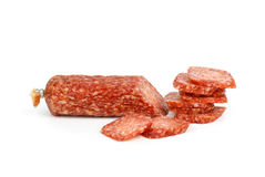 Sliced salami sausage. Isolated on the white background Royalty Free Stock Photo