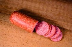 Sliced salami sausage on cutting board. Sliced salami sausage on a cutting board Stock Photography