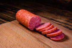Sliced salami sausage on cutting board. Sliced salami sausage on a cutting board Royalty Free Stock Image