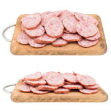 Sliced salami sausage on a cutting board. Isolated on white back Stock Photos